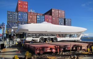 Maritimo Offshore Racing's race boat loaded on a ship for the journey to the USA.